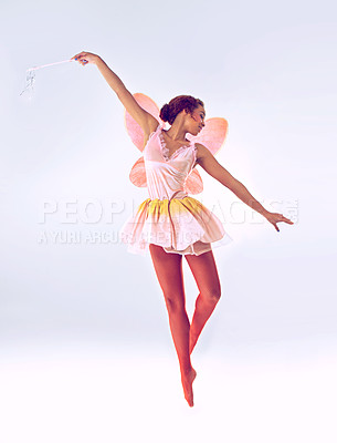 Buy stock photo A full length shot of a cute fairy dancing
