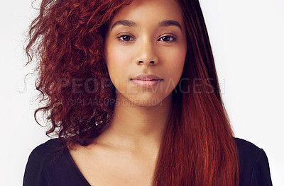 Buy stock photo A beautful woman with sleek hair on the one side, and messy on the other