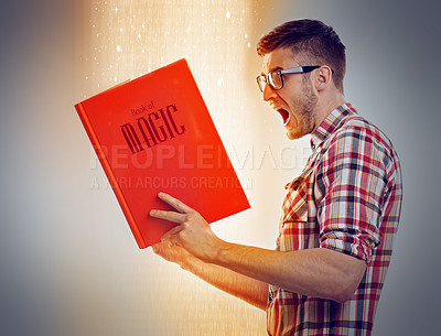 Buy stock photo A cropped shot of a young adult reading a book with glowing pages