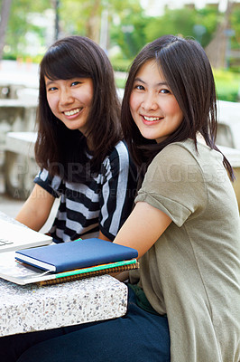 Buy stock photo Shot of two asian students on campus
