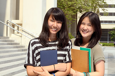 Buy stock photo Portrait of two female students standing together on campus