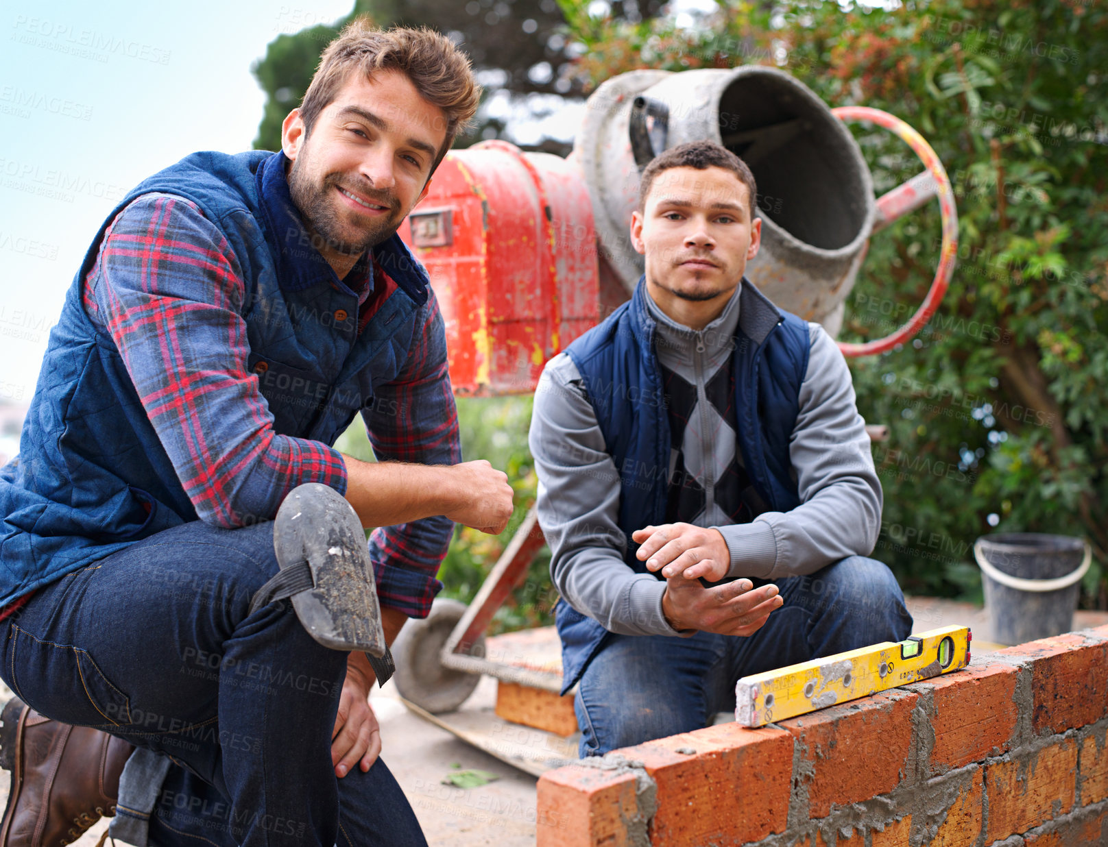 Buy stock photo Portrait of a bricklayer and his apprentice at work