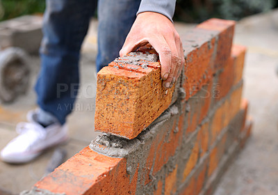 Buy stock photo Shot of a master bricklayer at work