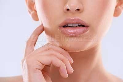 Buy stock photo Cropped studio shot of a young woman with beautiful skin