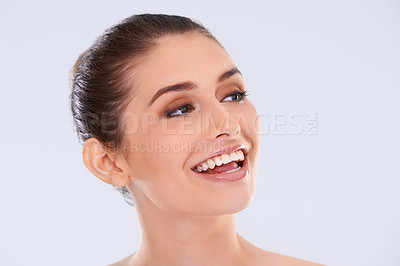 Buy stock photo Shot of a beautiful young woman with flawless skin laughing in studio