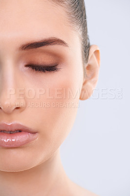 Buy stock photo Closeup studio shot of a beautiful young woman with flawless skin