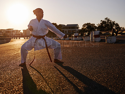 Buy stock photo A young woman in a gi practicing her kata