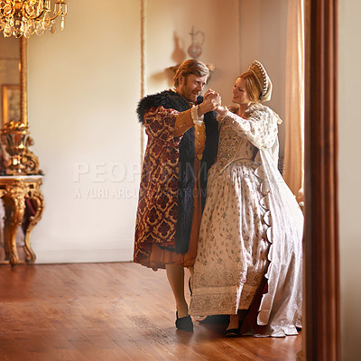 Buy stock photo A king and queen dancing together in their palace