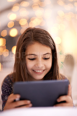 Buy stock photo Shot of a cute little girl using a digital tablet