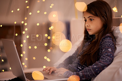 Buy stock photo Shot of a cute little girl using a laptop at home