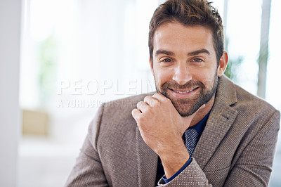 Buy stock photo Shot of a young man sitting in his office