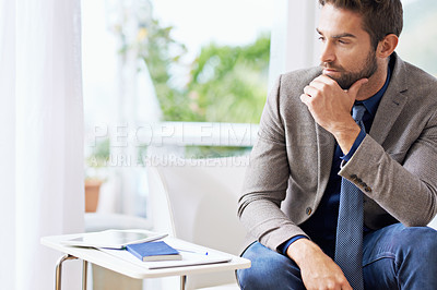 Buy stock photo Shot of a thoughtful businessman at the office