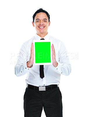 Buy stock photo A young businessman holding a tablet with a green screen
