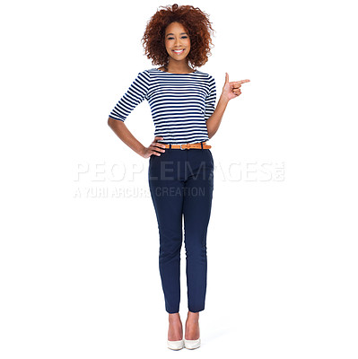 Buy stock photo Full-length studio shot of a beautiful young woman pointing to copyspace