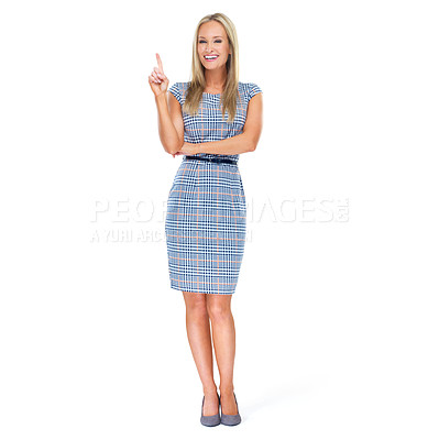 Buy stock photo Full-length studio shot of a beautiful young woman pointing up at copyspace