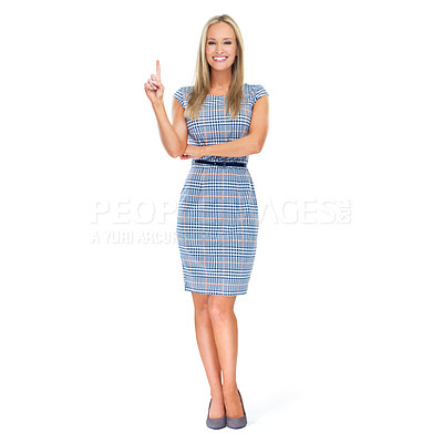 Buy stock photo Full-length studio portrait of a beautiful young woman pointing up at copyspace