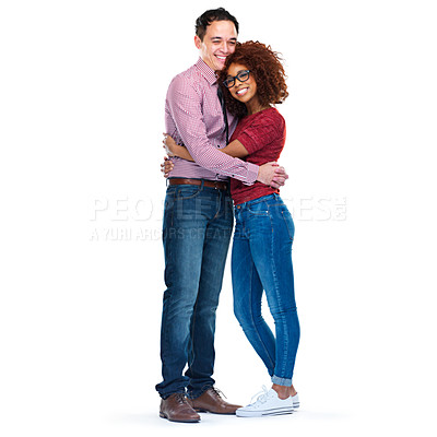 Buy stock photo Studio portrait of happy young couple standing against a white background