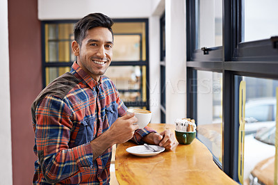 Buy stock photo A young man at a coffee shop