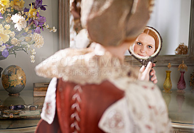 Buy stock photo Shot of a noble lady looking at herself in a mirror