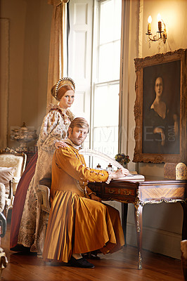 Buy stock photo Shot of an aristocratic couple writing a letter at an ornate table