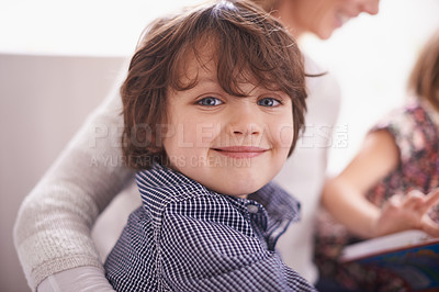 Buy stock photo Portrait of a young boy sitting with his mother and sister
