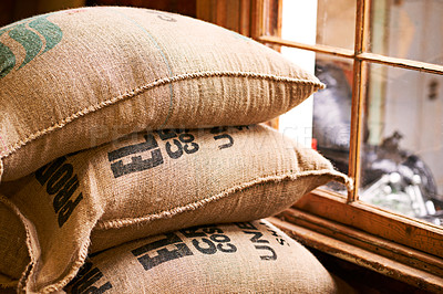 Buy stock photo Shot of a burlap sack full of unprocessed coffee beans
