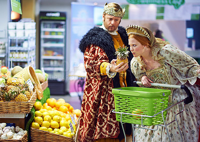 Buy stock photo A view of a king and queen in the supermarket feeling puzzled by the produce