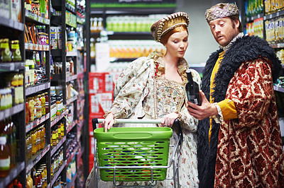 Buy stock photo A king and queen selecting wine in the supermarket