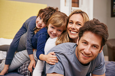 Buy stock photo Portrait of a young family being playful at home