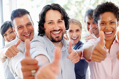 Buy stock photo Successful young business people showing thumbs up sign