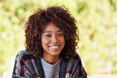Buy stock photo A radiant young black woman smiling broadly at the camera
