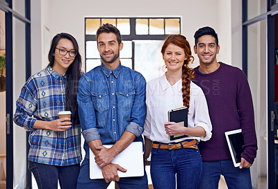 Buy stock photo Cropped portrait of a group of young designers standing in their office
