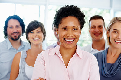 Buy stock photo Young business woman with her team in background