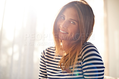 Buy stock photo Cropped shot of a beautiful young woman bathed in window light