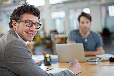 Buy stock photo Portrait of  two people working together in a large office