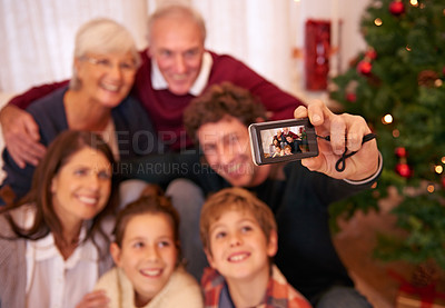 Buy stock photo Shot of a happy family taking a photo on Christmas