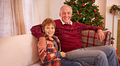 Buy stock photo Shot of a young boy and his granddad on Christmas