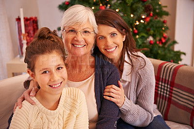 Buy stock photo Show of three-generations of a family celebrating christmas together