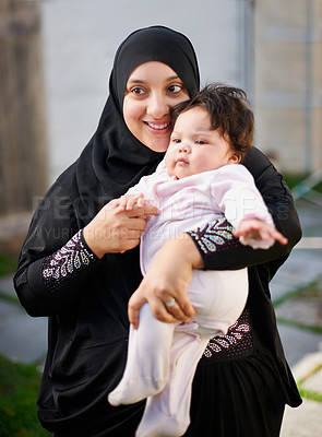 Buy stock photo Shot of a muslim mother and her little baby girl