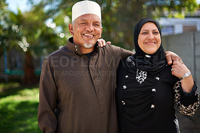 Buy stock photo Portrait of a smiling senior muslim couple outside
