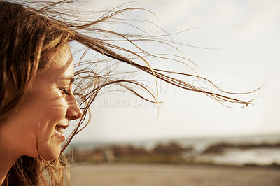 Buy stock photo Cropped view of a young woman with the wind in her hair