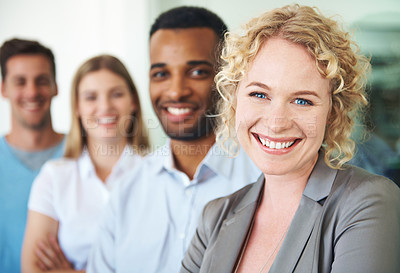 Buy stock photo A group of smiling coworkers standing together