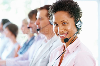 Buy stock photo Female customer service representative wearing headphones and smiling