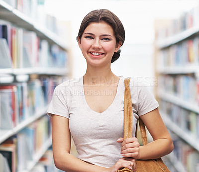 Buy stock photo Shot of student smiling sweetly as she begins the journey of education