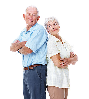 Buy stock photo Studio shot of a smiling elderly couple standing back to back isolated on white