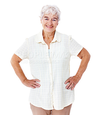 Buy stock photo Studio portrait of a smiling elderly woman standing with her hands on her hips isolated on white