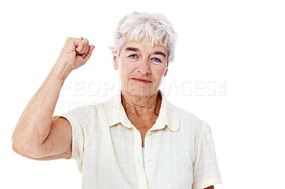 Buy stock photo Studio portrait of a serious-looking elderly woman with her arm raised isolated on white