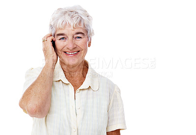 Buy stock photo Studio shot of a smiling elderly woman talking on a cellphone isolated on white