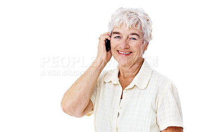 Buy stock photo Studio portrait of a smiling elderly woman talking on a cellphone isolated on white