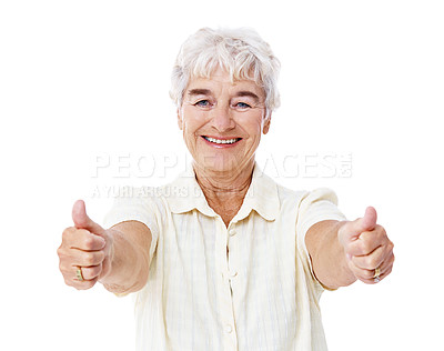Buy stock photo Studio portrait of a smiling elderly woman giving two thumbs up isolated on white